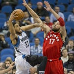 Minnesota Timberwolves center Karl-Anthony Towns (32) drives to the basket against Toronto Raptors center Jonas Valanciunas (17) in the first half Wednesday at Target Center in Minneapolis.