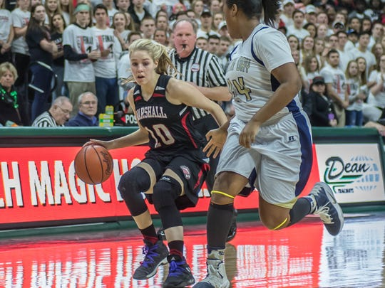 Marshall's Natalie Tucker (10) drives to the hoop during first half action against Dertroit Country Day at the Class B state semifinal Friday evening.