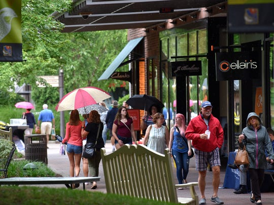 Patrons shop on a drizzly Saturday afternoon at The Mall at Partridge Creek. July 21, 2018.