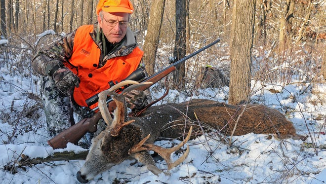 Patrick Durkin admires the 8-point buck he shot opening morning in Richland County.