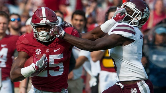 Alabama running back Joshua Jacobs (25) and the Crimson Tide remained atop the latest Colleg Football Playoff poll Top 25 released Tuesday on ESPN.