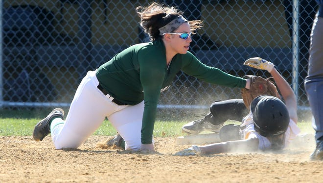 South Brunswick girls softball takes on East Brunswick at South Brunswick High School on Wednesday April 13, 2016East Brunswick's # 11-Megan Kelliher (left) puts the tag on South Brunswick's # 12-Gabby Branaccio for the out at third base.
