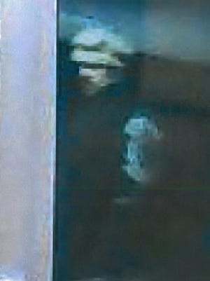 After a burglary at Loveland Middle School, police released this photo of a suspect seen breaking into the school.