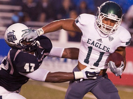Old Dominion University's TJ Ricks (47) grabs  Eastern Michigan's Tyler Allen (11) in the first half Sept. 13, 2014.