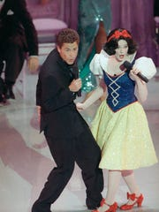 Actor Rob Lowe croons a tune to Snow White during the