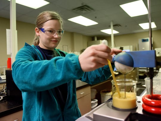 Kianne Gilles works in the lab on Thursday, April 6,