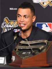 Miami Marlins player Giancarlo Stanton speaks at the Hank Aaron Award press conference before game two of the 2017 World Series between the Los Angeles Dodgers and the Houston Astros at Dodger Stadium in Los Angeles on Oct 25, 2017.