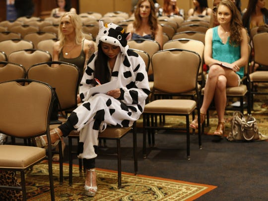 "Angelie Meehan, of Phoenix, wears a cow costume to her audition for ABC's ""The Bachelor"" at McCormick Ranch in Scottsdale on June 16, 2018. She said she was looking for ""that special bull for her life."""
