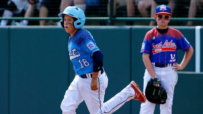 Bonita, California's Nick Maldonado (18) rounds first past Bowling Green, Kentucky's Carson Myers (12) after hitting a grand slam off Bowling Green's Ty Bryant during the third inning of a baseball game in United States pool play at the Little League World Series tournament in South Williamsport, Pa., Friday, Aug. 21, 2015. The West won 14-2. (AP Photo/Gene J. Puskar)