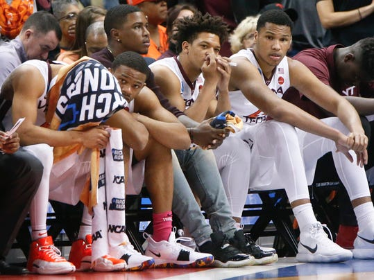 Virginia Tech players sit on the bench as their team is down to Alabama with time running out in an NCAA men's college basketball tournament first-round game, Thursday, March 15, 2018, in Pittsburgh. Alabama won 86-83. (AP Photo/Keith Srakocic)