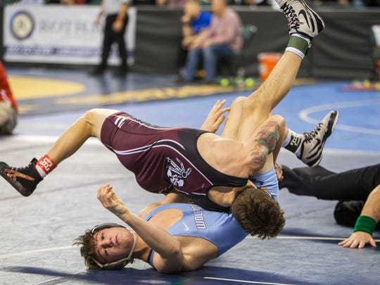 Cole Corrigan of Toms River South flips through and pins West Morris Central's Justin LeMay in their 145 lbs. match. Friday Rounds at NJSIAA Wrestling Championships at Atlantic City, NJ on March 3, 2017