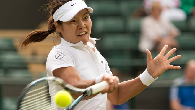 Li Na in action during her match against Barbora Zahlavova Strycova on day five of the 2014 Wimbledon Championships at the All England Lawn and Tennis Club.