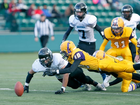 Section V Class D - Bishop Kearney's Ricky Lopez and Clyde-Savannah's Dylan Ufholz jump on a loose ball in the third quarter at Sahlen's Stadium in Rochester, N.Y. on Saturday, November 7 2015.