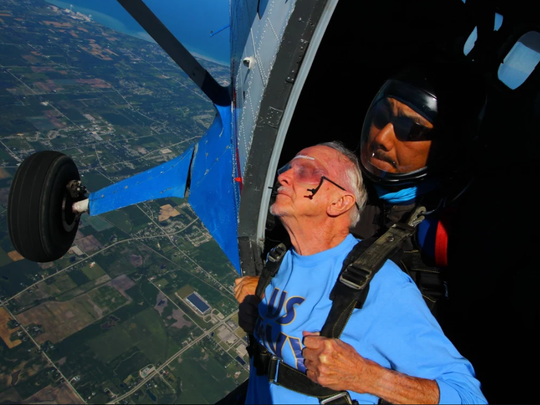 Chuck Chapeta, 91, peacefully composes himself for his jump with tandem instructor Kazu Oyama.