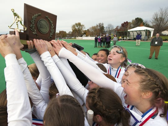 Bellows Falls celebrates the championship during the Division III field hockey state championship game at the University of Vermont.