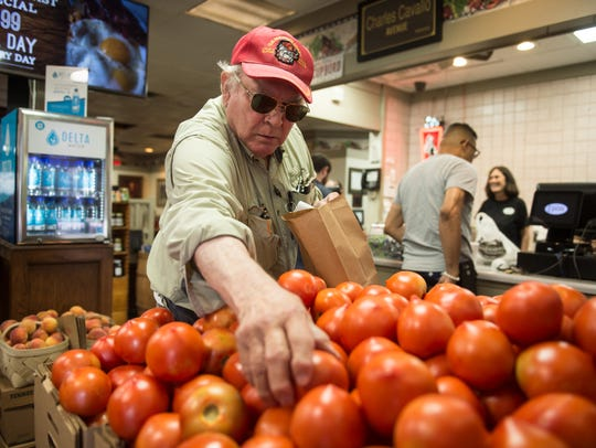 June 26, 2018 - Jim Carter chooses Ripley tomatoes to take home from Charles Cavallo's Cupboard Restaurant. The restaurant has been in business for more than seven decades.