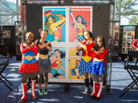 Wonder Woman's 75th Anniversary Celebrated on Forever Stamps.  L to R: Fatimata Gossama, Elizabeth Leyba, Tomoe Lin and Kimiro Fields of Girs Inc.