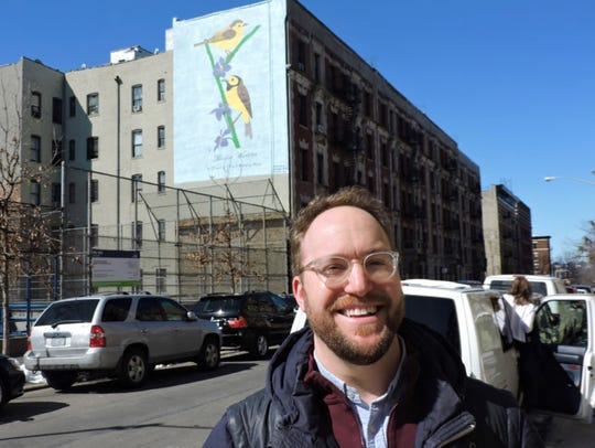 Avi Gitler in front of Brooklyn-based Gera Lozano's