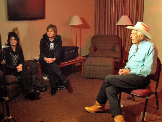 Filmmakers Jim McCool, far left, and Sevan Garabedian, second from left, interview guitarist Tommy Allsup in 2011 in Clear Lake, Iowa. Nicole Allsup and Connie Valens (second from right, sister of the late Ritchie Valens) sit at middle.