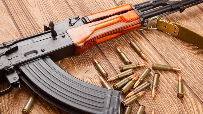 An AK-47 rifle with ammunition.