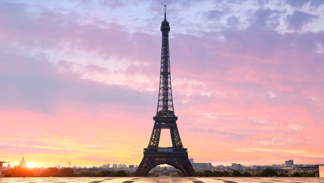 The Eiffel Tower in Paris at sunset.