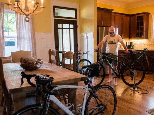 Victor Wilson poses with his 4 bikes in his home in