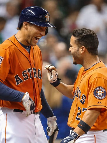 Jose Altuve, right, signed an extension to remain in
