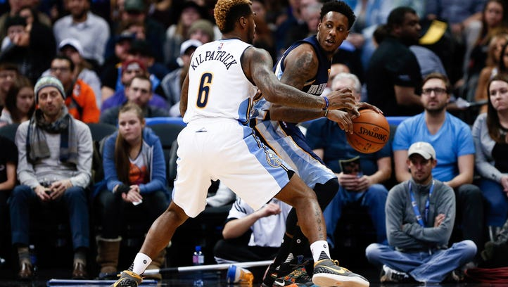 Denver Nuggets guard Sean Kilpatrick (6) defends Memphis Grizzlies guard Mario Chalmers (6) in the first quarter at the Pepsi Center.