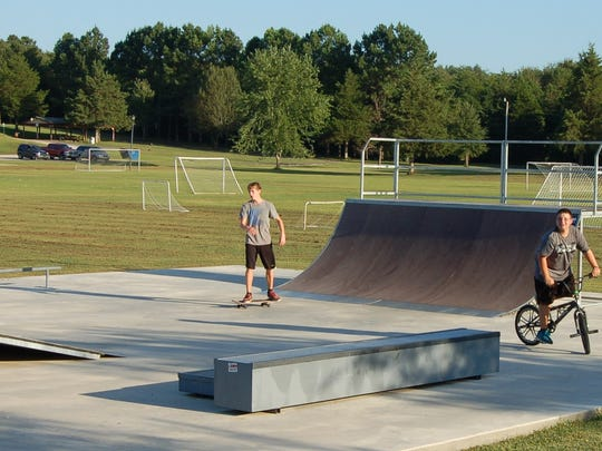 Dustin Balentine (left) and Nicholas Ragsdell spent Wednesday afternoon at the skateboard park inside Hickey Park in Flippin. The skate park was made possible by an anonymous donor.