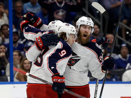 Columbus Blue Jackets left wing Artemi Panarin (9) celebrates his goal against the Tampa Bay Lightning with defenseman David Savard (58) during the third period of Game 2 of an NHL Eastern Conference first-round hockey playoff series Friday, April 12, 2019, in Tampa, Florida. Panarin left Columbus for the New York Rangers via free agancy, one of three former Blue Jackets to sign multi-year contracts elsewhere.