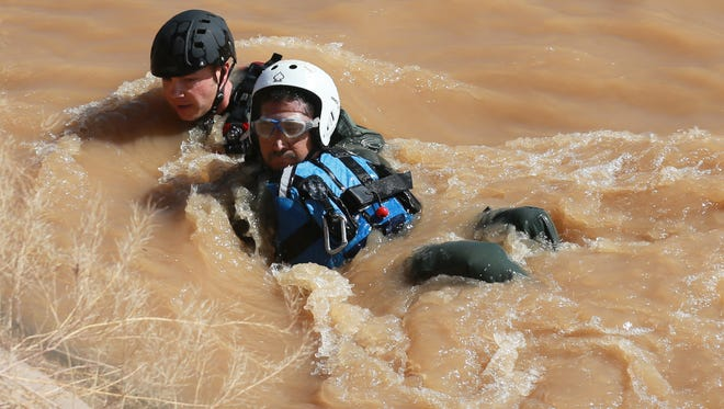 U.S. Border Patrol agents participate in a previous swift water rescue demonstration in a canal adjacent to the border highway in El Paso's Lower Valley.