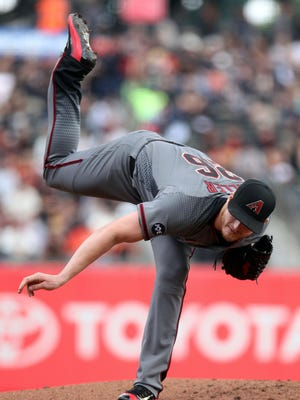 Apr 21, 2016: Arizona Diamondbacks starting pitcher Shelby Miller (26) throws to the San Francisco Giants in the first inning of their MLB baseball game at AT&T Park.