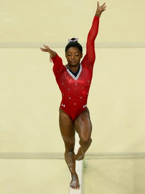 Physical balance, as shown by Olympian Simone Biles of the United States, is only part of the picture. Maintaining balance in your life can be just as challenging.