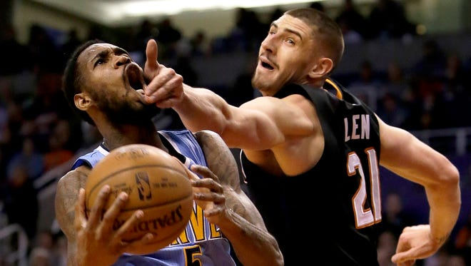 Denver Nuggets guard Will Barton (5) is fouled by Phoenix Suns center Alex Len in the first quarter during an NBA basketball game, Saturday, Jan. 28, 2017, in Phoenix.