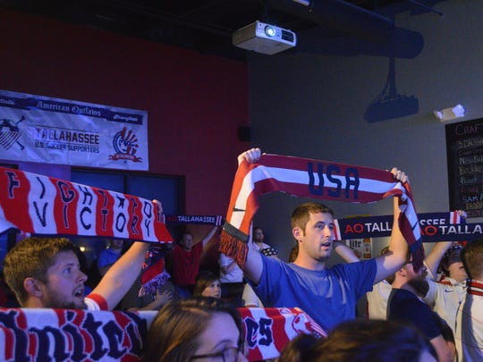 The Tallahassee chapter of the American Outlaws gather at Parlay to watch the USA Women's soccer match vs. Nigeria.