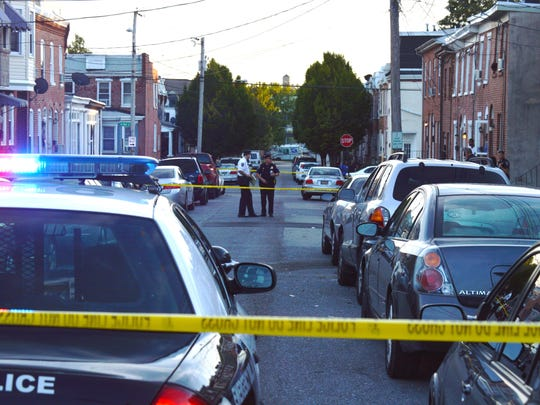 Wilmington police investigate a shooting in the 200 block of Delamore Place early Friday night.