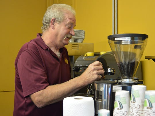 Dennis Lasher carefully prepares an iced coffee at his roastery, Indian River Espresso & Coffee Co., in Millsboro.