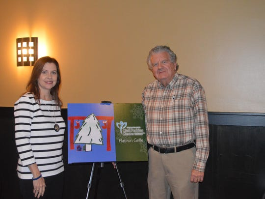 "Rita ""Mac"" McCaslin and Conrad Delaney spoke at a media luncheon in 2015 about the Rusty Mac Adopt-a-Teen Program."