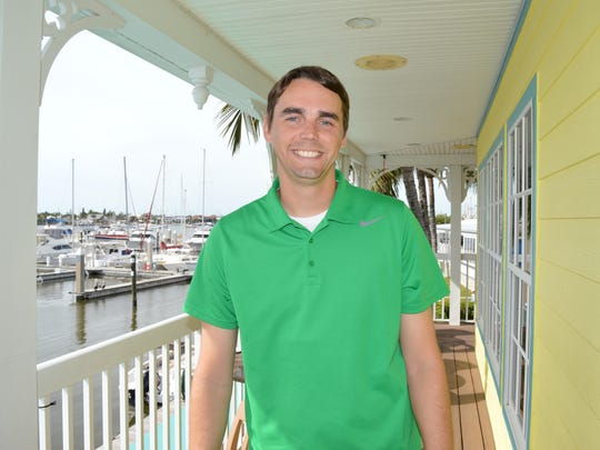 R.J. Snider, the marketing director for Salty Sam's Waterfront Adventures, coordinates the Caribbean Cruise-In Car Show.