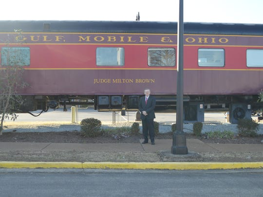 Bill Neal of Walking Wisely Life Services stands in front of the Judge Milton Brown Railcar at Casey Jones Village.