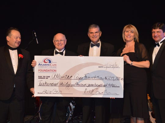 Joe Massaglia, chef/owner of Mama Mia's in Seaville and Atlantic Cape Community College Restaurant Gala Committee member; Dr. Peter L. Mora, president of Atlantic Cape Community College; Nick Cashan, president of Atlantic Cape Community College Foundation; Kimberly McCarron and Jim Rutala, co-chairs of Atlantic Cape Community College Restaurant Gala Committee, stand with a check displaying the funds raised at the 33rd annual Atlantic Cape Restaurant Gala on March 24.