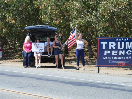 Donald Trump supporters await the caravan that included the Republican presidential canditate to leave Tulare Tuesday. Trump was in town for a fundraiser.