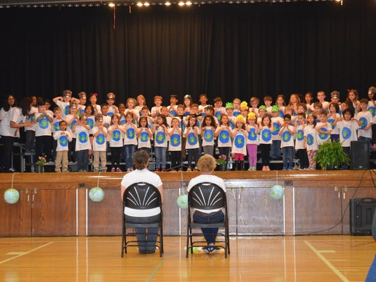 Center Grove kindergarteners gave an Earth Day concert for their families and friends. The songs were about protecting the earth.