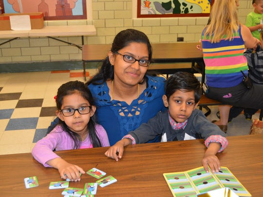 Center Grove Preschoolers in Randolph invited their moms to a special Mother's Day celebration. Pictured here, mom Ramya Devi plays a matching game with her children Aditi and Adhirit Devi.