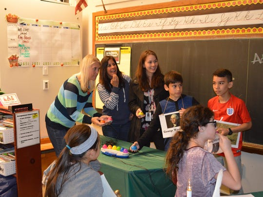 """Center Grove fifth graders challenged parents and school district administrators in a game of """"Are You Smarter Than a Fifth Grader?"""" From left to right, Lori Layton, Linda Ferris, Elementary Supervisor Katherine Thorn and winning fifth grader Chris Ferris and Ricardo Sanchez."""