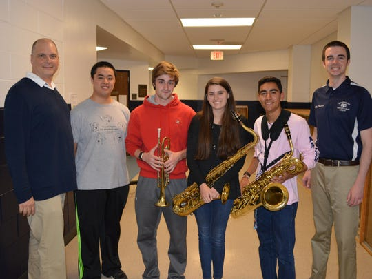The Jazz at Lincoln Center's Essentially Ellington Regional Festival recognized Randolph High School jazz musicians Frank Zhang, Shane Ebneth, Sabrina Labold and Jonathan Ceballos as outstanding soloists and awarded the students scholarships to attend Summer Jazz Camp at Newark Academy. The students are pictured left to right with with RHS Jazz Ensemble Director Dave Miller, left, and music teacher Bob Davidson, right.