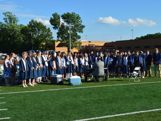 "The Randolph High School combined choirs sing ""Finale B"" from the musical ""Rent"" during the Class of 2017 commencement ceremony on June 21."