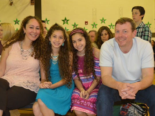 Mom Anne Jens and dad Ben Jens enjoy the fifth grade moving up ceremony in the Shongum School gymnasium on June 16 with daughters Rose and Lily Jens.