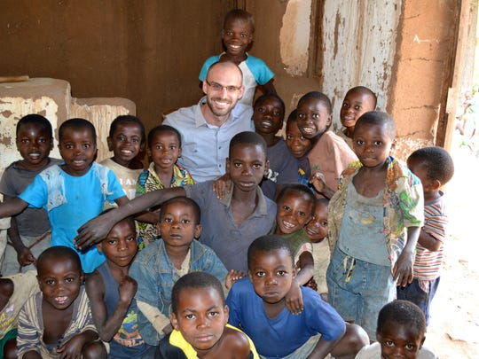 Fond du Lac native Jonathan Strong working with children during his global health work in the Congo, Africa, as a John Hopkins faculty researcher.