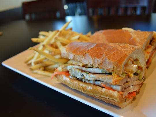 The Pork Banh Mi is a Hot Dish at Fat Katz Sports Bistro in Fort Myers.